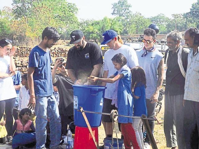 Nyjah Huston sharing a light moment with tribal children in Janwaar.