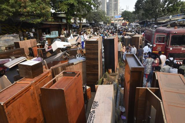 High Quality Furniture Was Shifted Out Of The Market At Oshiwara To Ensure The Fire Does  Not Spread Further. (Satish Bate/HT PHOTO)