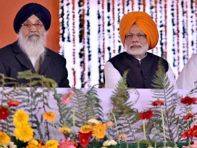 Prime Minister Narendra Modi with Punjab CM Parkash Singh Badal and deputy CM Sukhbir Singh Badal at a function to mark the 350th birth anniversary celebrations of Shri Guru Gobind Singh Ji at Anandpur Sahib Gurudwara in Punjab on Friday.