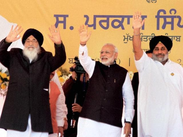 Prime Minister Narendra Modi, Punjab CM Parkash Singh Badal and deputy CM Sukhbir Singh Badal wave at the crowd during a rally organised for the laying of foundation stone of All India Institute of Medical Sciences (AIIMS) in Bathinda on Friday.