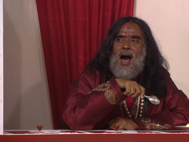 Swamiji is upset when he is chosen for punishment and starts abusing Rohan.