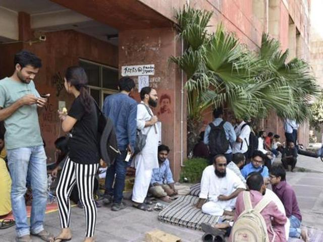 Students protest outside the admin block at JNU in New Delhi.