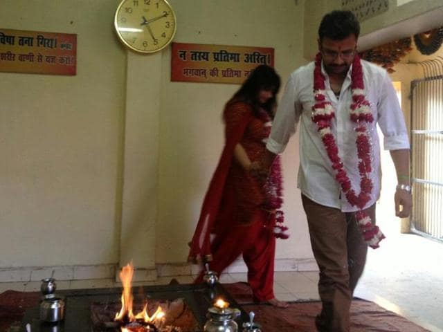 Aman Mani Tripathi and Sara during their wedding at an Arya Samaj temple in Lucknow in July 2013.