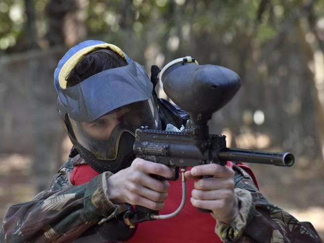 A visitor tries his hand at paintballing at the Garden of Five Senses on Friday.