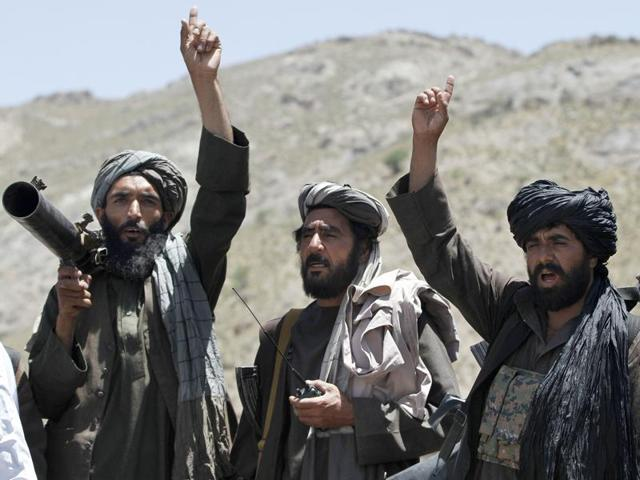 In this May 27, 2016 file photo, Taliban fighters react to a speech by their senior leader in the Shindand district of Herat province, Afghanistan. After operating out of Pakistan for more than a decade, the leaders of Afghanistan's Taliban movement may have moved back to their homeland to try to build on this year's gains in the war and to establish a permanent presence.