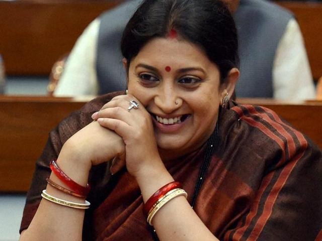 Union minister Smriti Irani apparently had her footwear repaired at a local cobbler in Coimbatore in Tamil Nadu on November 26, 2016, paying Rs 100 for a Rs 10-service.(PTI)