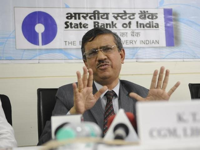 Chief general manager of SBI, MP & Chhattisgarh circle, K T Ajit (centre) addresses a press conference in Bhopal on Friday.