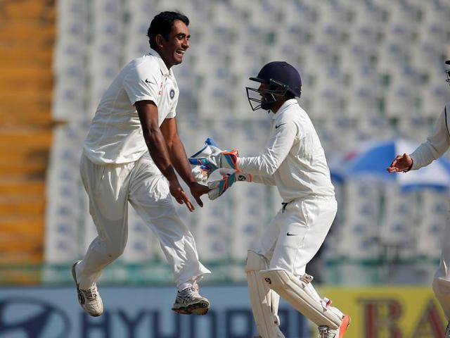 Jayant Yadav (left) celebrates with Parthiv Patel and Cheteshwar Pujara, the wicket of England's Joe Root.  Jayant, Ravindra Jadeja and Ravichandran Ashwin systematically decimated the England batting line-up on Day 1 of the third Test in Mohali on Saturday.