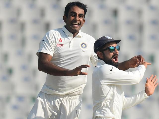 Jayant Yadav (left) celebrates with his captain Virat Kohli after dismissing England's Joe Root during the first day of the third Test cricket at the PCAStadium in Mohali. Jayant scalped two wickets on Saturday.