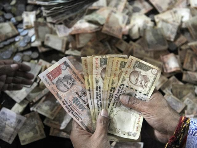 Temple priests at Sanatan Dharm Temple in sector 19 in Noida were seen checking Rs 500 and Rs 1000 notes in the donation box of the temple.