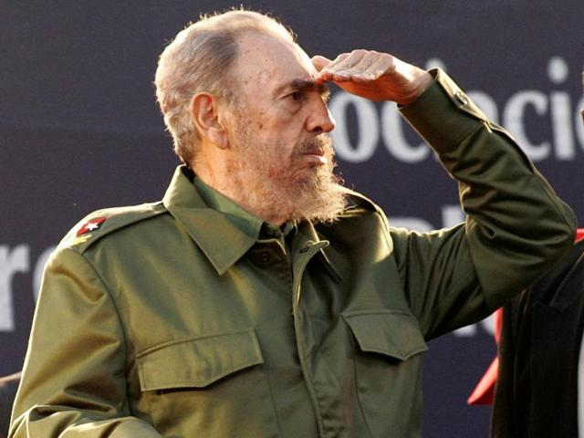 In this file photo, Cuba's leader Fidel Castro gestures at a speaking event as he explains that he does not understand why he is not blind after all the camera flashes he has received in Havana.