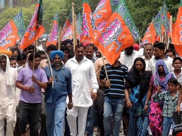 BJP workers take part at a rally in Uttarakhand