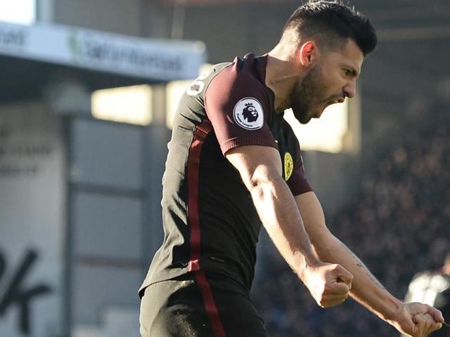 Manchester City's Sergio Aguero celebrates with teammate Nolito (right) after scoring their second goal against Burnley.