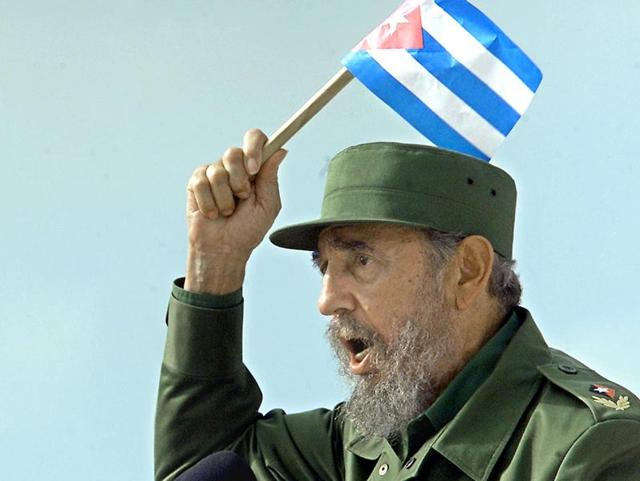 Cuban President Fidel Castro speaking to a crowd, holding a Cuban flag, in Sancti-Spiritus, some 340 km east of Havana.
