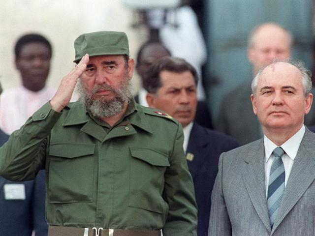 This file photo taken on April 2, 1989 shows Cuban president Fidel Castro (L) welcoming general secretary of the Communist Party of the Soviet Union Mikhail Gorbachev (R) during the official ceremony for Gorbachev's arrival in Havana.