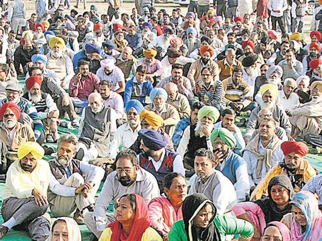 Members of State Ministerial Services Union protesting at the GLADA ground on Chandigarh Road, Ludhiana, on Friday. The protest later shifted to Vardhman Chowk where they blocked traffic for an hour.
