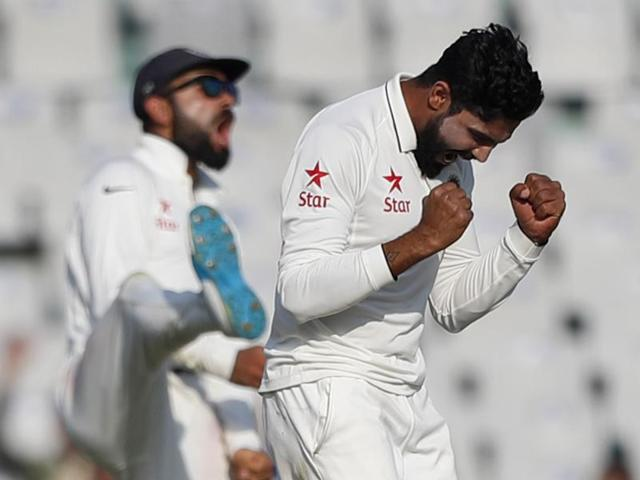 India captain Virat Kohli (left) will be hoping his spinners, Ravindra Jadeja, Jayant Yadav and Ravichandran Ashwin, will bowl out England early into Day 2 in Mohali.(AP)