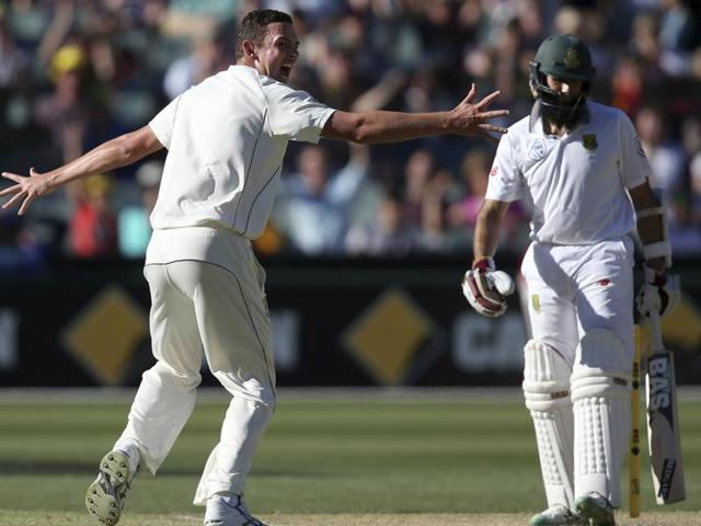 Australia's Josh Hazlewood (left) celebrates the wicket of South Africa's Hashim Amla during the third day of the day-night Test at Adelaide Oval. Amla fell after edging a Hazlewood away swinger.