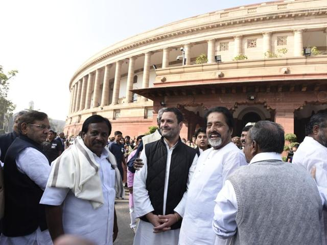 Congress Vice president Rahul Gandhi with MPs of Opposition parties during a protest outside Parliament against the government's move to demonetise high tender notes, in New Delhi on Wednesday.