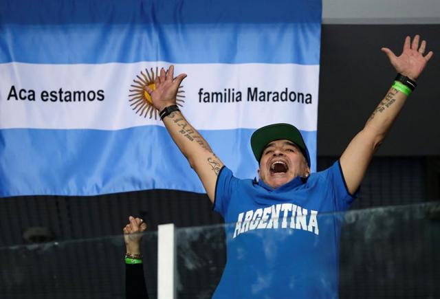 Argentina and Croatia fans take selfies with Argentine football legend Diego Maradona after the Davis Cup World Group final singles match between Croatia and Argentina in Zagreb.