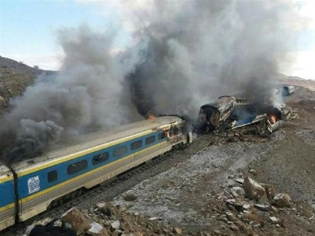 This picture released by Iranian Fars News Agency shows the scene of two trains collision about 150 miles (250 kilometers) east of the capital Tehran, Iran, Friday, Nov. 25, 2016.
