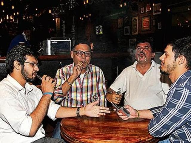 Rahul Jathar, Niteen Thansalkar, Jay Kapadia and Vishal Jathar at a Mumbai vape club meet. Members travel  miles to exchange notes and share discoveries. 'I'd come even if there was just one other person,' Kapadia says.