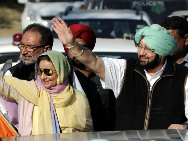 Punjab Congress president Captain Amarinder Singh, along with his MLA wife Preneet Kaur, and other party leaders during a road show at Ghanour in Patiala on Saturday.