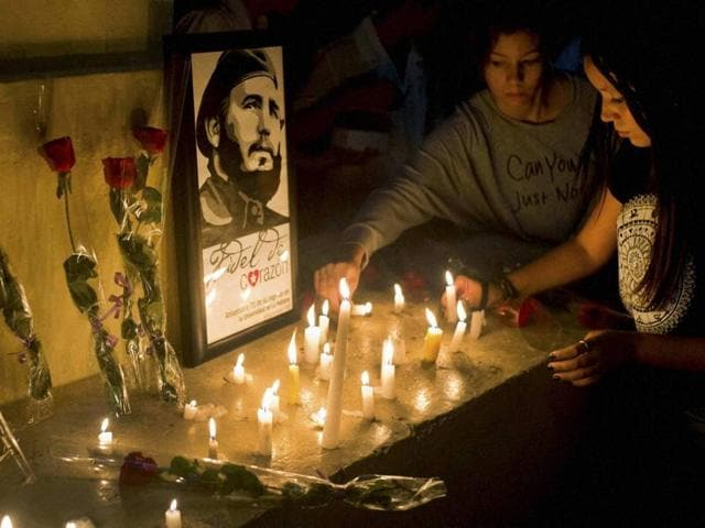 Students place candles around an image of the late Cuban leader Fidel Castro, at the university where Castro studied law, in Havana, Cuba, on Saturday.