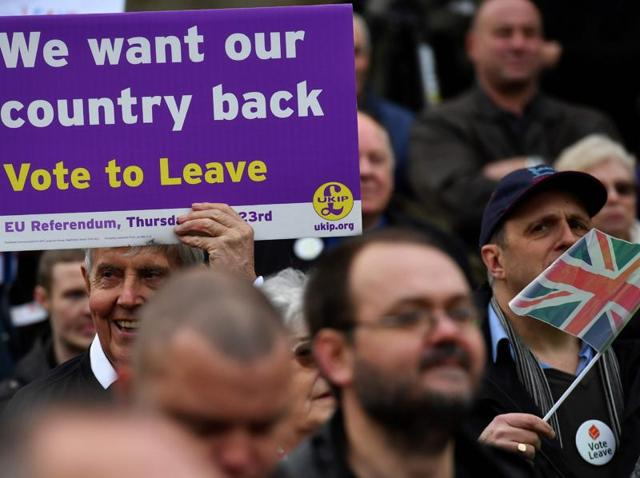A protestor holds a placard during an anti-European Union demonstration outside the Houses of Parliament in London on November 23.