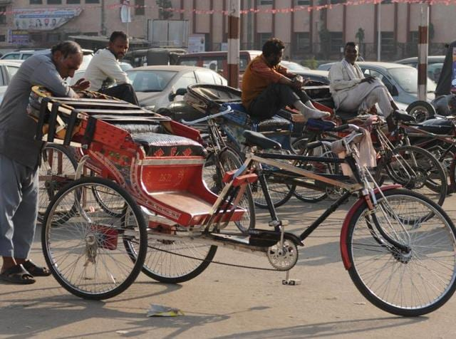 Rickshaw-pullers sitting idle as they wait for passangers in Jalandhar on Saturday.