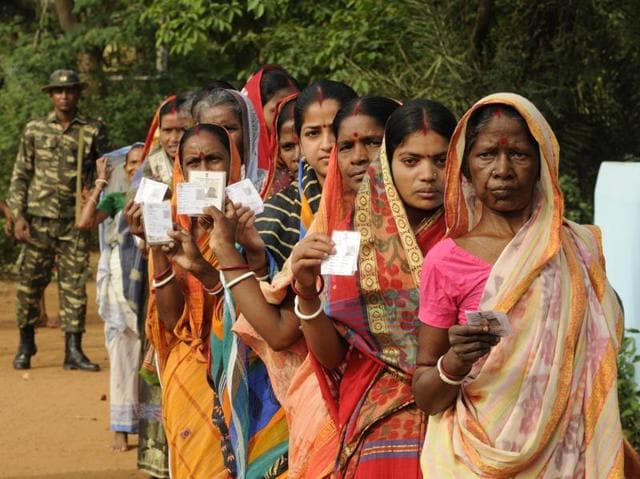 People stand in queue to cast their vote at Belpahari, West Midnapore on April 04, 2016 during the first phase of West Bengal assembly elections.