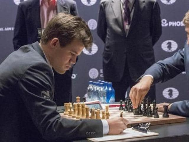 Magnus Carlsen drew with Sergey Karajkin in Game 11 of the World Chess Championship.(AP)