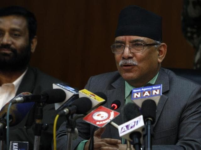 Nepalese prime minister Pushpa Kamal Dahal, also known as Prachanda (R), talks with the media at a press conference in Kathmandu.