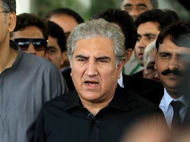 Shah Mehmood Qureshi, a senior leader of opposition party Pakistan Tehreek-e-Insaf (PTI), speaks to the media outside the Supreme Court building during the hearing of cases regarding the