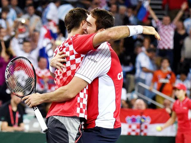 Croatia's Ivan Dodig (left) and Marin Cilic celebrate after winning their Davis Cup World Group final doubles match against Argentina at the Arena hall in Zagreb on Saturday.