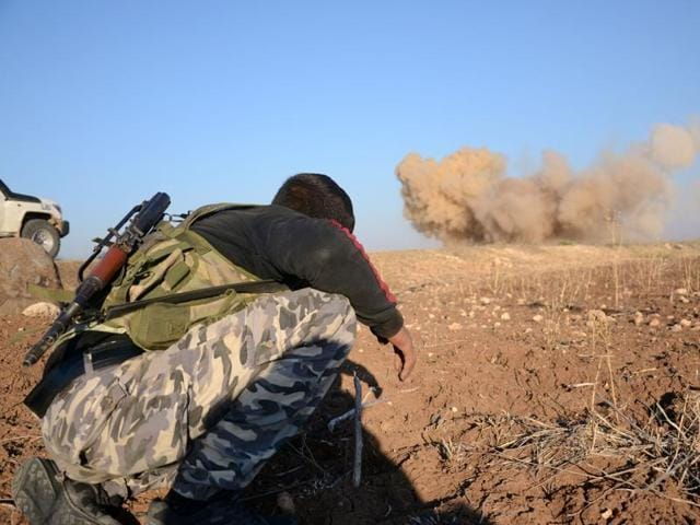 A rebel fighter reacts as a landmine, planted by Islamic State (IS) group jihadists, is exploded by his comrades in the village of Tilalayn on the western outskirts of the northern Syrian town of Dabiq, on November 25.