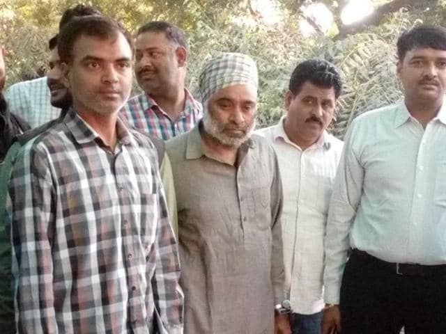 Khalistan Liberation Force chief Harminder Singh Mintoo, centre, was arrested from the railway station in Delhi.(HT Photo)
