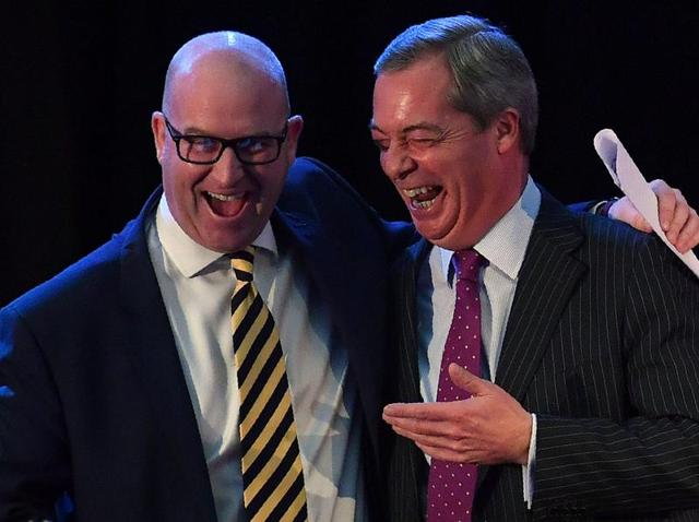 Former UK Independence Party (UKIP) leader Nigel Farage (right) reacts as he poses with newly elected leader  Paul Nuttall following the leadership announcement in London on November 28, 2016. The anti-EU party elected former history lecturer Nuttall as its new leader to take over from Farage, a political ally of US president-elect Donald Trump.