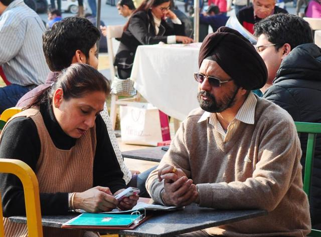 People having food outside the Back packers café at Elante Mall , Chandigarh on Sunday.