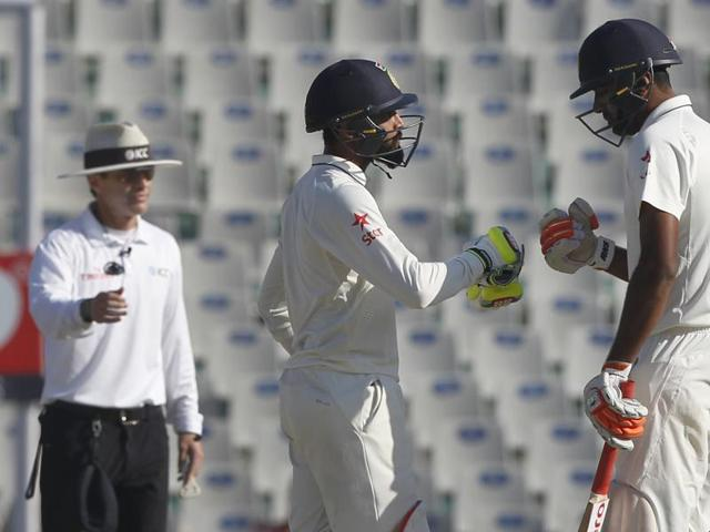 Ravichandran Ashwin (left) and Ravindra Jadeja run between the wickets in the Mohali Test(BCCI)