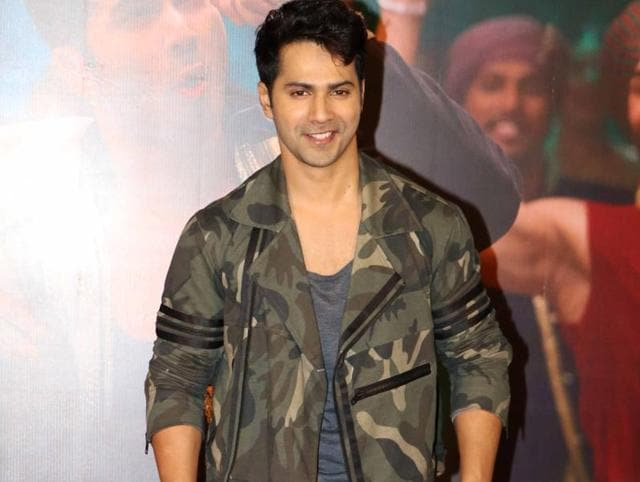 Ace casual chic like actor  Varun Dhawan in a sporty,  military jacket.