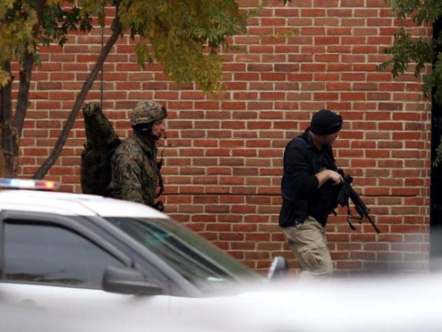Law enforcement officials are seen outside of a parking garage on the campus of Ohio State University as they respond to an active attack in Columbus, Ohio, on November 28, 2016.