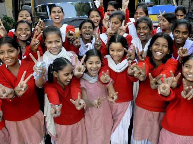 Students before they get ready to board auto-rickshaws at Government High School, Lakkar Bazaar, in Ludhiana.