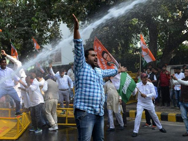 Members of the Indian Youth Congress shout slogans against the government as they are hit by a water cannon during a protest against the demonetisation at  Jantar Mantar in New Delhi on November 18. The Congress has clarified it hasn't called a shutdown but will hold protest demonstrations.