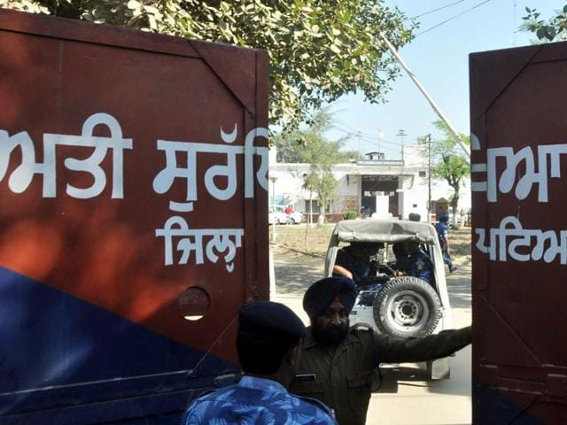 A police personnel stands at the gate of the Nabha maximum-security jail on Monday.