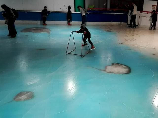 People skate on in an ice rink with 5,000 frozen dead fish inside at the Space World amusement park in Kitakyushu, southwestern Japan.