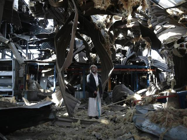 Yemeni security and medical officials say at least 13 civilians have been killed by an airstrike by the Saudi-led military coalition in a western port city.