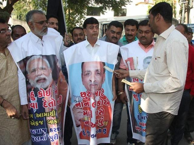 Congress supporters protest against Prime Minister Narendra Modi over the ban on Rs 500 and Rs 1000 notes outside Gujarat chief minister Vijay Rupani's house in Rajkot on Sunday.