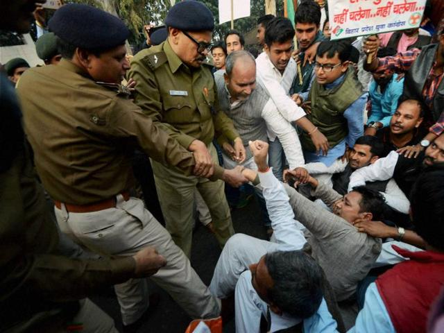 Police detain Youth Congress workers during a protest against the demonetisation exercise, in Patna on Sunday.