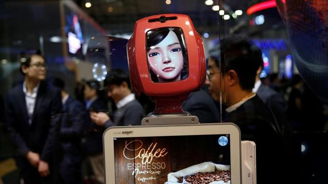 Commerce Bot, a robot that provides customer service with artificial intelligence technology and voice recognition is seen at SK telecom's stand